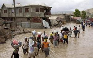 Haitians wade through a flooded town in the aftermath of Hurricane Ike, September 2008